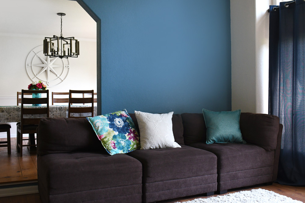 living room with blue accent wall