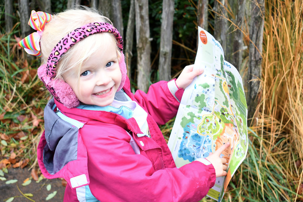 Seattle Woodland Park Zoo child holding a map