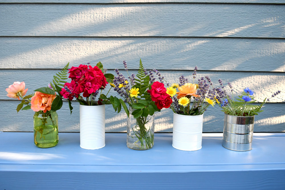 Recycled glass jars and tin cans flower vase idea