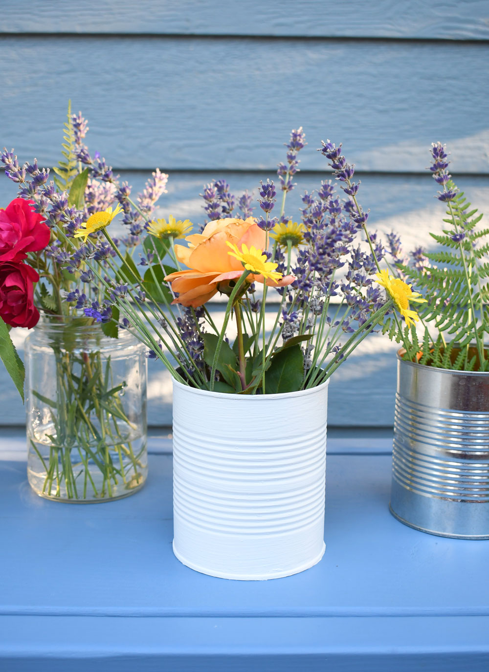 Make flower vases from recycled glass jars and tin cans