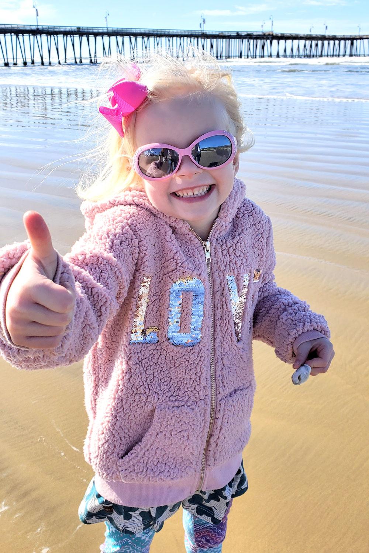 Girl wearing sunglasses Pismo Beach California
