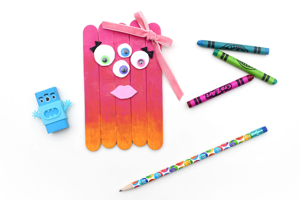 Pink popsicle stick monster kids craft