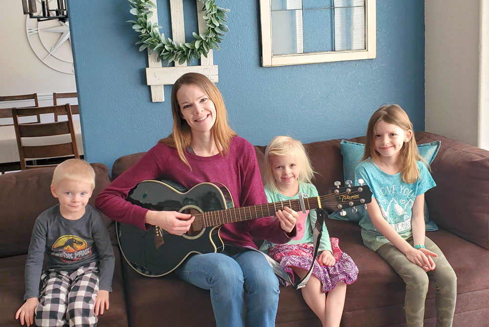 Morning couch time for homeschool can include reading books, playing guitar and singing songs